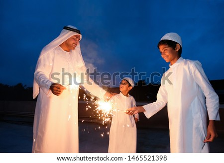 An arabic family  enjoying the sparkle of the festivity during festival celebration. #1465521398