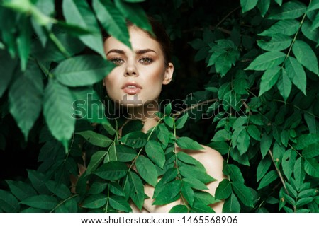 young woman portrait in leaves #1465568906
