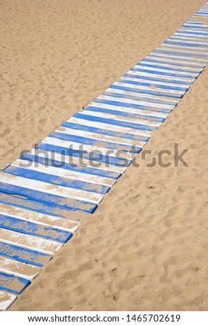 Plastic boardwalk on the sand, in the beach, known as La Concha, in San Sebastian city. #1465702619