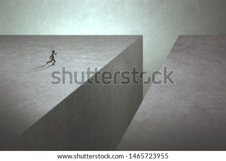 ambitious man taking run up to make a big jump to reach the other side of the precipice #1465723955