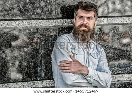 Guy masculine appearance with long beard. Barber concept. Beard grooming. Beard care. Man attractive bearded hipster posing outdoors. Masculinity and manliness. Confident posture of handsome man. #1465912469