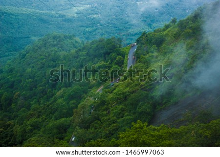 The beautiful Ghat roads of Kerala hill station. An awesome road trip to travel with friends and family. Photo taken during monsoon early in the morning.