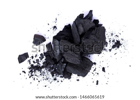 Heap of natural broken black activated charcoal granular and powder isolated on white background. Top view. #1466065619