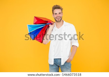 Consumerism concept. Big discount. Great choices great purchases. Happy man holding purchases in paper bags. Cheerful client customer consumer smiling with fashion purchases. Impulse purchases. #1466073518
