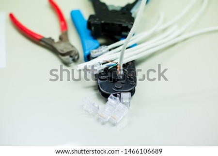 Crimper and wire cutter isolated on a white background. Twisting Cable Tool Twisted Pair Ethernet UTP Cat 5, Crimping RJ45 LAN cable, Stepping to crimping RJ45 connector. #1466106689