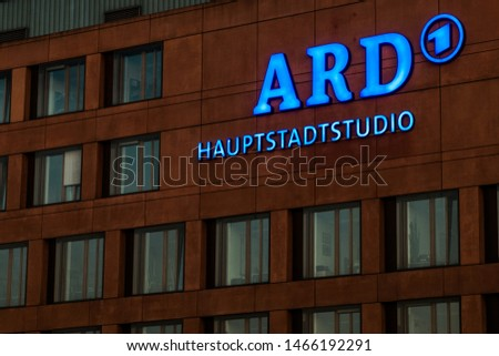 Berlin, Germany, July 2019, Facade with blue logo of the capital studios from the ARD (German public broadcaster) in the government District in Berlin Mitte  #1466192291