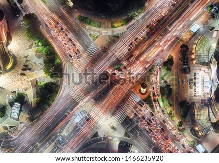 Night top view of road intersection at downtown of Seoul in South Korea. Cars and colorful buses on streets in evening. Night city traffic. Seoul is a popular tourist destination of Asia. #1466235920