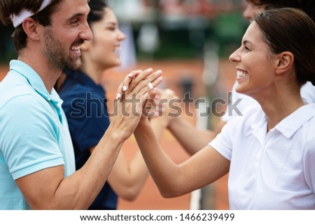 Group of tennis players giving a handshake after a match #1466239499