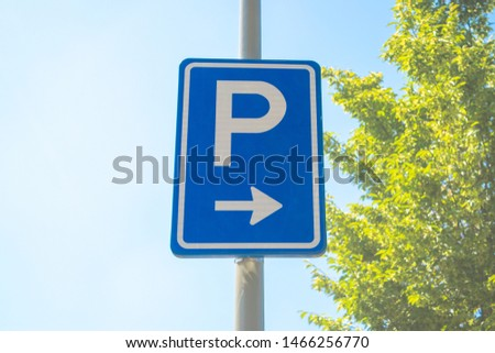 Dutch road sign: You can park your car on the right