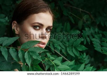 woman in leaves portrait of tropics #1466289599
