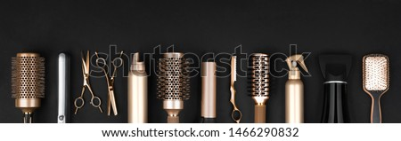 Collection of professional hair dresser tools arranged on dark background #1466290832