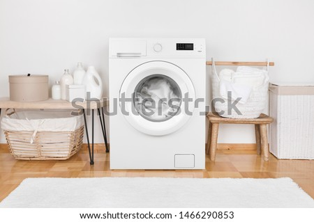 Domestic room interior with modern washing machine and laundry baskets #1466290853