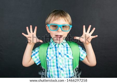 Back to schhol concept - funny boy in front of blackboard, copy space #1466297258