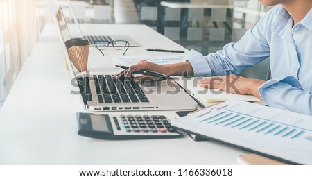 Administrator business man financial inspector and secretary making report calculating balance. Internal Revenue Service checking document. Audit concept #1466336018