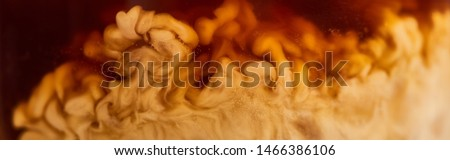 close up view of coffee mixing with milk in glass, panoramic shot #1466386106