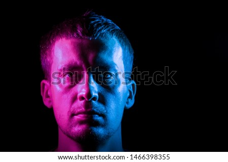 Portrait of a man in full face illuminated with pink and blue #1466398355