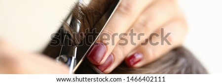 Female Fingers Trimming Male Hair by Scissors. Hairdresser Hands Cutting Haircut for Male. Woman with Manicure Making Hairdo for Man Client. Hairstylist Using Tool for Hairstyling Close-up Photo #1466402111