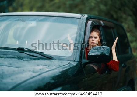 Woman driving a car trip lifestyle trip nature trip #1466454410