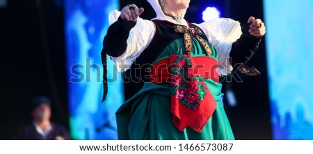 Hispanic lady dancer from Spain performing on stage. Folkloric heritage dancer lady in traditional costume  #1466573087