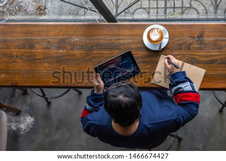 Asian females investor using tablet to follow stock market #1466674427