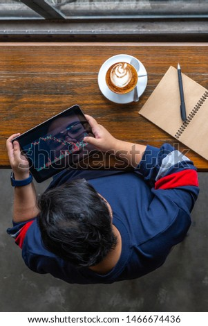 Vertical photo of investor watching stock trading graph on tablet #1466674436