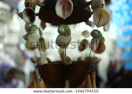 Home decoration of beads made from sea shells, photographed with a blur and bokeh background #1466794550