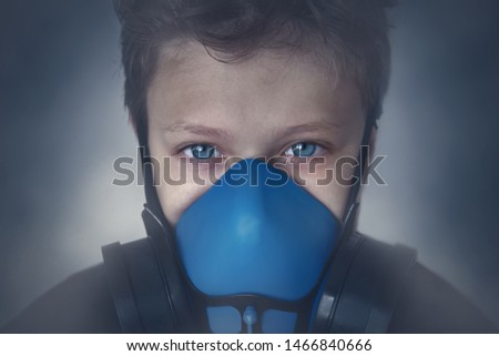Young boy wearing gasmask, respirator portrait. Effects of worldwide air pollution, industrial influence on environment. Protection from dangerous air particles, gas, smog, transmitted diseases #1466840666