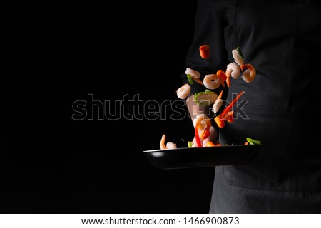 Chef prepares shrimps with vegetables, seafood, healthy food, Asian food. Hotel business and menu in restaurants, recipe book. On black background, banner #1466900873