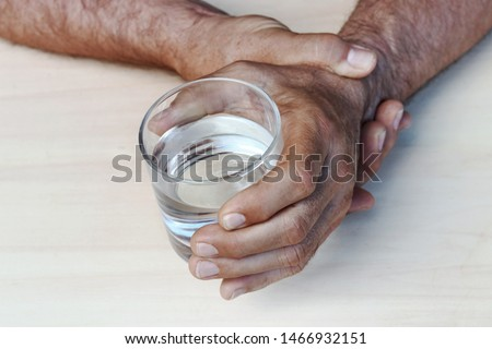 The hands of a man with Parkinson's disease tremble. Strongly trembling hands of an older man  #1466932151