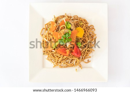 Chinese fried noodle server with fresh vegetable and on a square white plate #1466966093