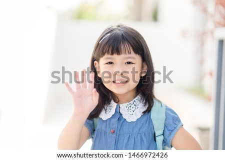 5 years old happy little asian kindergarten student girl ready to go to school and waving goodbye or say hi isolated on white background.back to school concept #1466972426