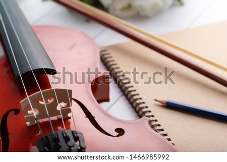 Close-up shot violin orchestra instrumental over white wooden background shallow depth of field select focus #1466985992
