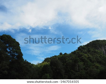 Beautiful blue sky and fluffy cloud with top of mountain view. Fresh and relax background. Nature in the forest concept. #1467016505