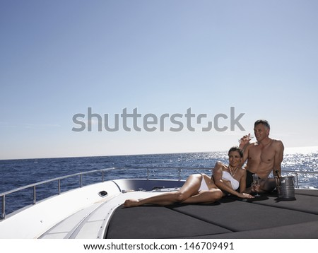 Loving couple drinking champagne while relaxing on yacht #146709491