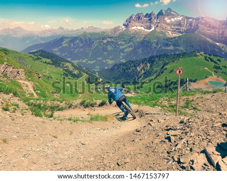 Mountain bike downhill rider on downhill trail #1467153797