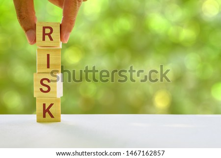 Financial risk assessment and portfolio risk management concept : Stack of vertical 4 cubes on a table with a letter R, I, S, K on each cubes, depicts managing / control asset risk to gain high return #1467162857