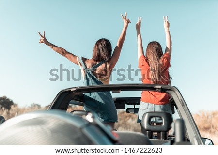 Beautiful girls and young people traveling with jeep car in a sunset in a beach landscape #1467222623