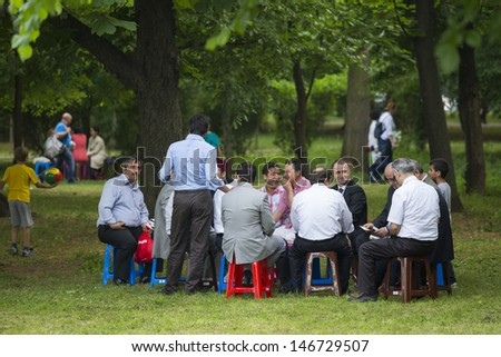 BUCHAREST, ROMANIA - MAY 17: Unidentified group of people  gather, relax and socialize in the park during the celebratory event Turkish Festival on May 17, 2013 in Bucharest, Romania. #146729507