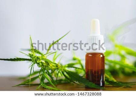Bottle of CBD oil on cannabis background. Medical cannabis with extract cbd. Wellness Hemp Cannabidiol. Premium marijuana products #1467328088