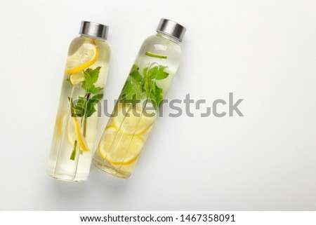 Bottles of fresh infused water on white background #1467358091