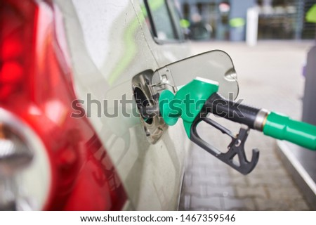 Car refueling on a petrol station. close up view #1467359546