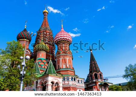 St. Basil's Cathedral on Red Square in Moscow, Russia. Planes flying over the cathedral to commemorate Victory Dat. #1467363413