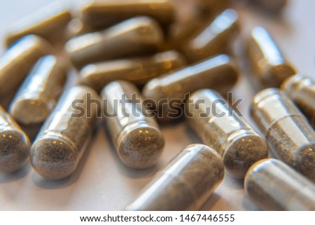 Pharmaceutical medicine pills and capsules. Pills background. medicine tablets and pills background. Health care. Macro of stomach pill #1467446555