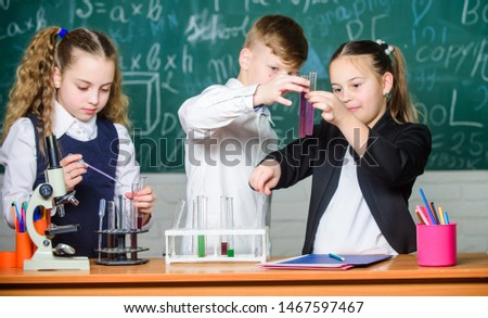 Chemistry science. Little kids scientist earning chemistry in school lab. biology experiments. Little children. Science. Lab microscope and testing tubes. Breathing life into chemistry. #1467597467