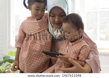 Portrait of young asian mother and son  using gadgets at home #1467611048