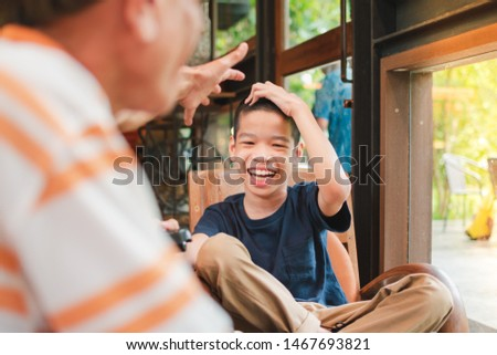Disabled child on wheelchair and his dad spend the holidays doing indoor activities with fun, They sit in a coffee shop, Life in the education age of special Children, Happy disabled kid concept. #1467693821