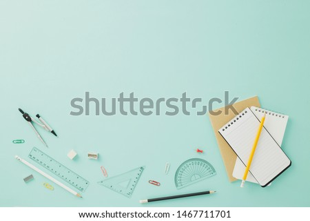 Creative arrangements of stationery on pastel pale blue background. Top view or flat lay. Education concept. Office desk with copy space.