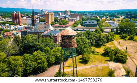 Wilkes-Barre, Pennsylvania cityscape with an old water tower in the foreground. #1467758276