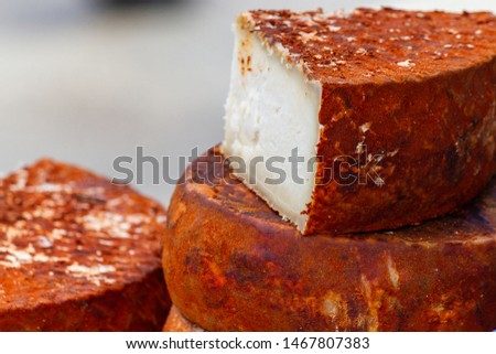 Traditional canarian white cheese with red rind  Royalty-Free Stock Photo #1467807383