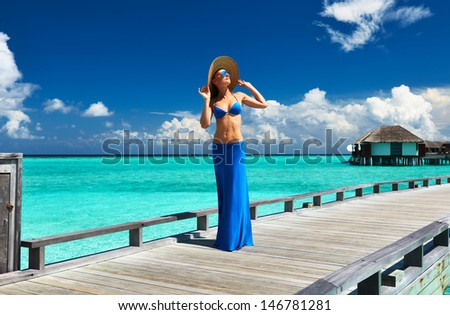 Woman on a tropical beach jetty at Maldives #146781281